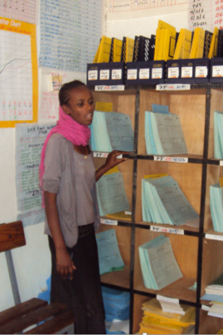 Health working in Ethiopia uses the Family Folder system to track health services. Photo by MEASURE Evaluation.